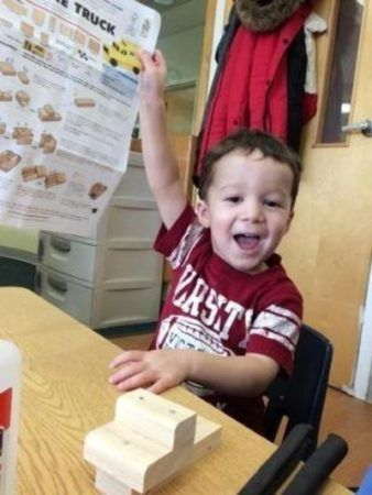 preschool_boy_excited_to_work_on_truck_at_next_generation_childrens_centers_marlborough_ma-338x450
