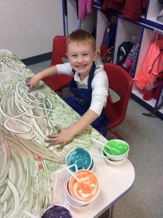 preschool_boy_fingerpainting_growing_kids_academy_fredericksburg_va-336x450
