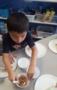 preschool_boy_getting_food_for_snack_winwood_childrens_center_lansdowne_va-283x450