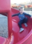 preschool_boy_going_down_slide_cadence_academy_preschool_greensboro_nc-336x450