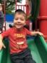 preschool_boy_going_down_slide_next_generation_childrens_centers_westford_ma-336x450