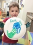 preschool_boy_holding_earth_day_paper_plate_art_carolina_kids_child_development_center_fort_mill_sc-336x450