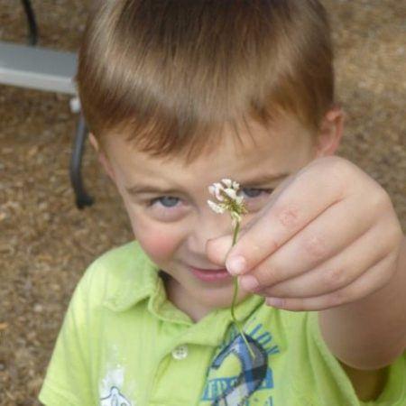 preschool_boy_holding_flower_cadence_academy_preschool_louisville_ky-450x450