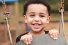 preschool_boy_in_swing_at_carolina_kids_child_development_center_fort_mill_sc-675x450