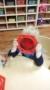 preschool_boy_looking_through_red_lense_sunbrook_academy_at_chapel_hill_douglasville_ga-248x450