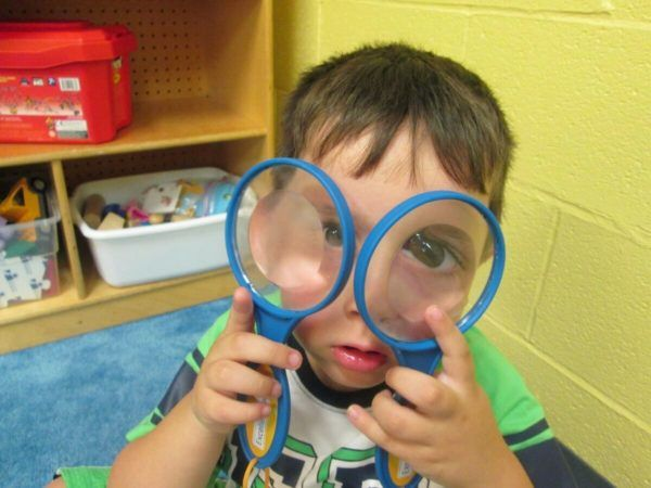 preschool_boy_looking_through_two_magnifying_glasses_prime_time_early_learning_centers_east_rutherford_nj-600x450