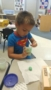 preschool_boy_making_green_playdough_winwood_childrens_center_gainesville_va-253x450