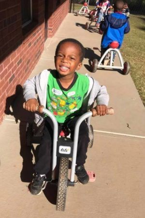 preschool_boy_on_tricycle_at_sunbrook_academy_at_stockbridge_ga-300x450