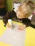 preschool_boy_painting_with_dobber_at_cadence_academy_preschool_mount_pleasant_sc-338x450