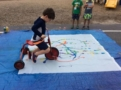 preschool_boy_painting_with_tricycle_at_next_generation_childrens_centers_franklin_ma-603x450