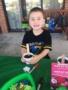 preschool_boy_planting_flowers_cadence_academy_preschool_surfside_myrtle_beach_sc-338x450