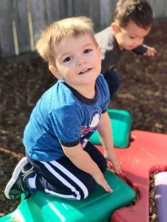 preschool_boy_playing_on_playground_equipment_cadence_academy_preschool_summerville_sc-338x450