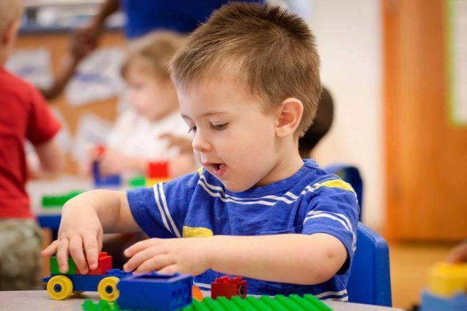 preschool_boy_playing_with_car_and_legos_sunbrook_academy_at_barnes_mill_austell_ga-675x450