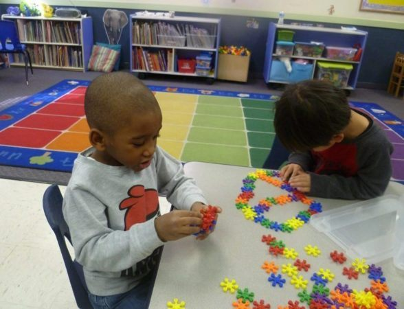 preschool_boy_playing_with_interlocking_stars_winwood_childrens_center_fairfax_va-588x450