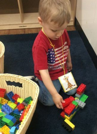 preschool_boy_playing_with_large_legos_cadence_academy_preschool_west_bridgewater_ma-326x450