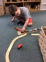 preschool_boy_playing_with_trains_at_next_generation_childrens_centers_franklin_ma-336x450