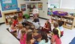 preschool_boy_presenting_art_to_class_fredericksburg_childrens_academy_fredericksburg_va-752x438