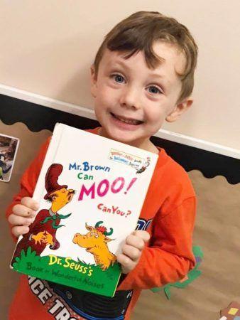 preschool_boy_reading_dr_seuss_book_cadence_academy_preschool_summerville_sc-338x450