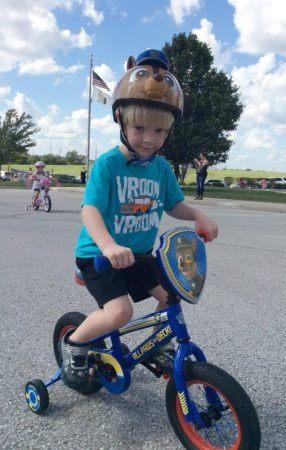 preschool_boy_riding_bike_during_st_jude_trike-a-thon_canterbury_academy_at_prairie_ridge_olathe_ks-286x450