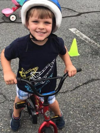preschool_boy_riding_bike_during_st_jude_trike-a-thon_growing_kids_academy_fredericksburg_va-338x450