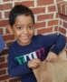 preschool_boy_smiling_outside_cadence_academy_preschool_mallard_charlotte_nc-372x450