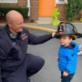 preschool_boy_trying_on_a_fire_fighter_hat_prime_time_early_learning_centers_edgewater_nj-450x450