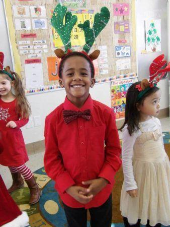 preschool_boy_wearing_antlers_cadence_academy_preschool_northeast_columbia_sc-338x450