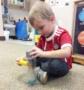 preschool_boy_with_pipe_cleaner_cadence_academy_preschool_greensboro_nc-421x450