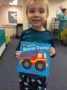 preschool_boy_with_rescue_trucks_book_cadence_academy_chesterfield_mo-335x450