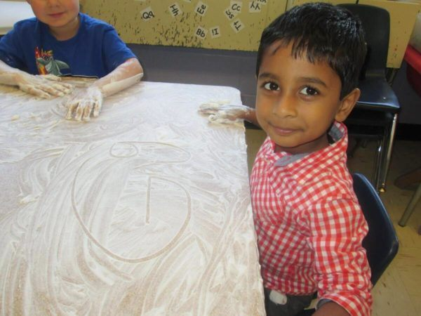 preschool_boy_writing_the_letter_g_prime_time_early_learning_centers_east_rutherford_nj-600x450