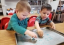 preschool_boys_colored_liquid_science_activity_the_bridge_learning_center_carrollton_ga-637x450