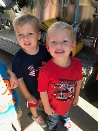 preschool_boys_in_front_of_firetruck_bearfoot_lodge_private_school_wylie_tx-338x450