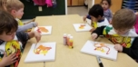 preschool_boys_painting_on_canvas_winwood_childrens_center_reston_va-752x365