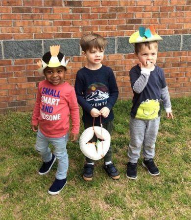 preschool_boys_with_plate_hats_cadence_academy_preschool_greensboro_nc-390x450
