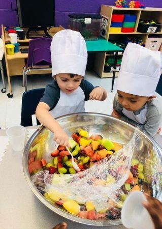 preschool_chefs_dishing_out_fruit_salad_prime_time_early_learning_centers_hoboken_nj-319x450