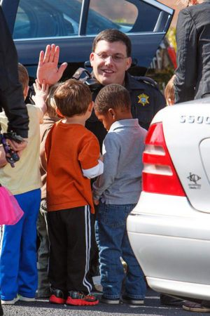 preschool_children_and_police_officer_at_cadence_academy_preschool_harbison-300x450