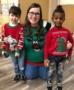 preschool_children_and_teacher_in_christmas_sweaters_cadence_academy_preschool_yelm_highway_olympia_wa-370x450