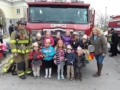 preschool_children_and_teacher_standing_in_front_of_fire_truck_canterbury_preparatory_school_overland_park_ks-600x450