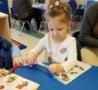 preschool_children_cutting_with_scissors_at_cadence_academy_preschool_northeast_columbia_sc-488x450