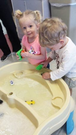 preschool_children_enjoying_water_table_at_cadence_academy_preschool_charleston_sc-253x450