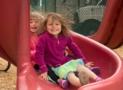 preschool_children_going_down_slide_cadence_academy_preschool_sherwood_or-613x450
