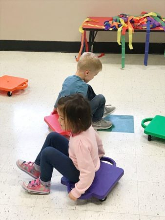 preschool_children_on_scooters_gateway_academy_mckee_charlotte_nc-338x450