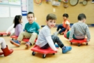 preschool_children_playing_on_rollers_winwood_childrens_center_brambleton_va-675x450