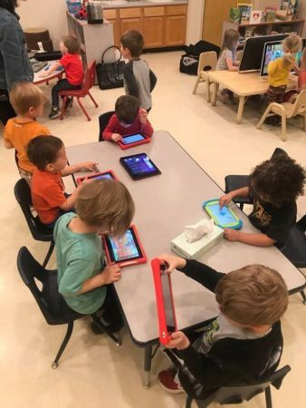 preschool_children_playing_on_tablets_cadence_academy_preschool_crestwood_ky-338x450