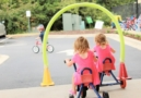 preschool_children_riding_tricycles_at_carolina_kids_child_development_center_fort_mill_sc-645x450