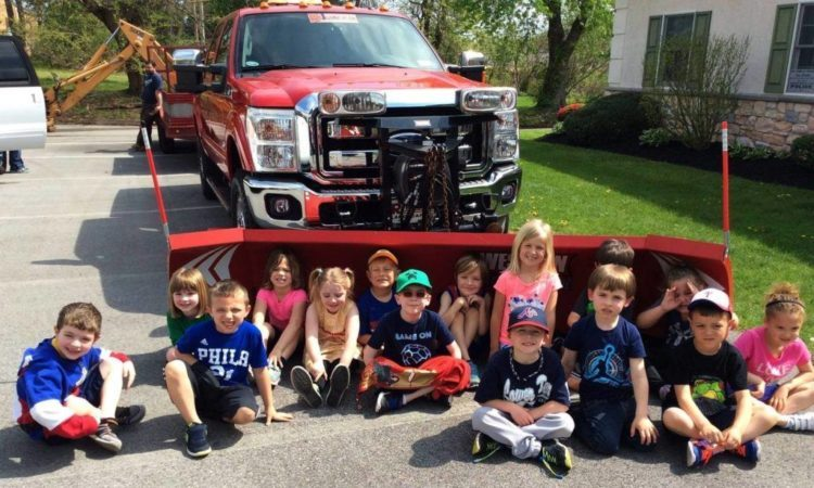 preschool_children_sitting_in_front_of_truck_at_cadence_academy_collegeville_pa-1024x614-750x450