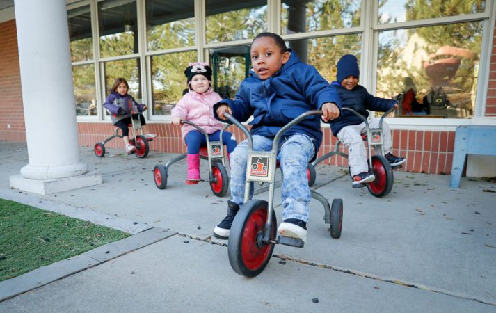 preschool_children_tricycles_cadence_academy_burr_ridge_il-713x450