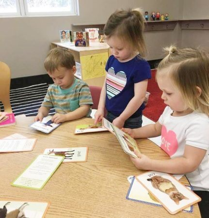 preschool_children_with_reading_cards_gateway_academy_mckee_charlotte_nc-431x450