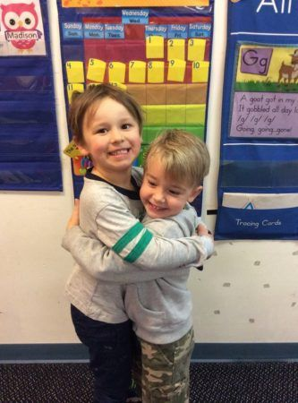 preschool_friends_hugging_growing_kids_academy_fredericksburg_va-333x450
