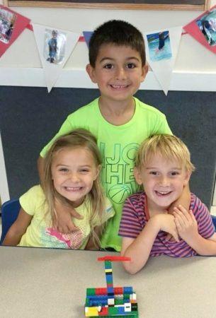 preschool_friends_posing_in_front_of_legos_winwood_childrens_center_lansdowne_va-305x450